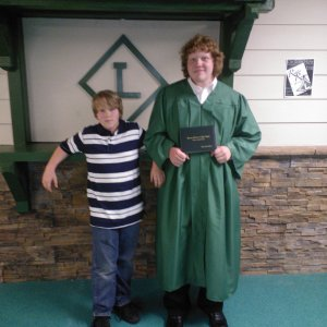 My 2 boys, JT and Josh. Jt says hes sorry for the messy hair, it was hot in that cap and gown,