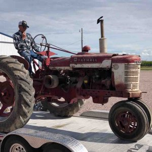 1950 farmall H, with wide axle.  This is unloading it after it's trip from the farm in NE Iowa, to it's current home in Nebraska.  Restoration will co